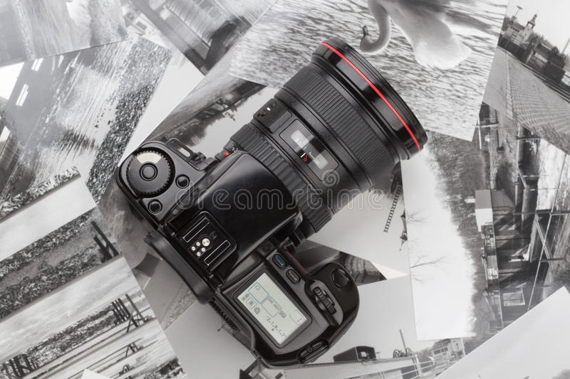 Analog SLR camera. With background of old photos stock photography