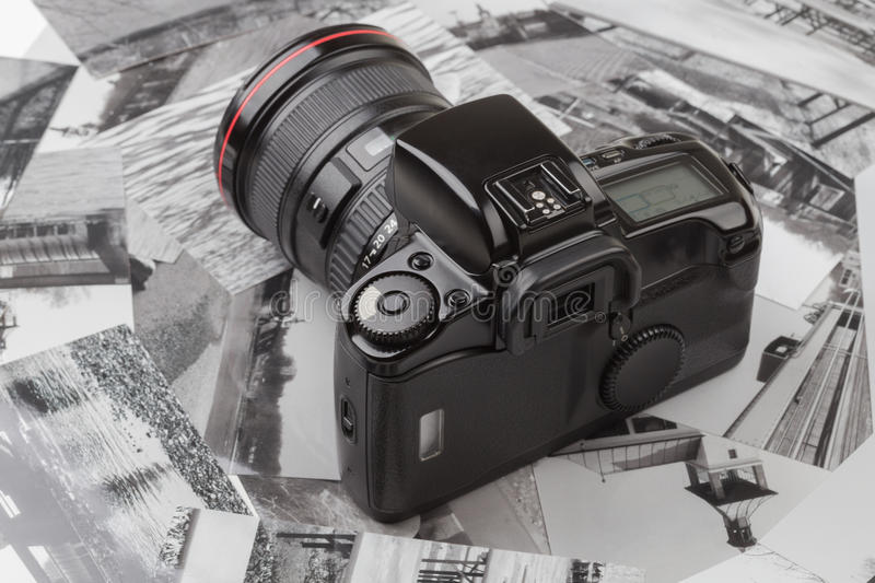 Analog SLR camera. With background of old photos royalty free stock photo