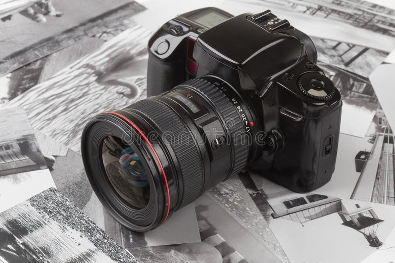Analog SLR camera. With background of old photos royalty free stock photos