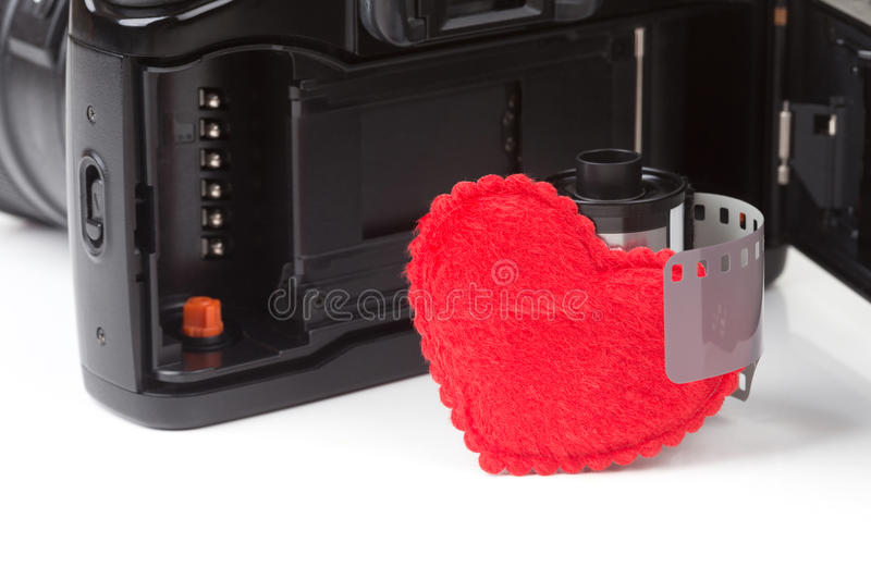 Analog SLR camera. With film and heart stock photos