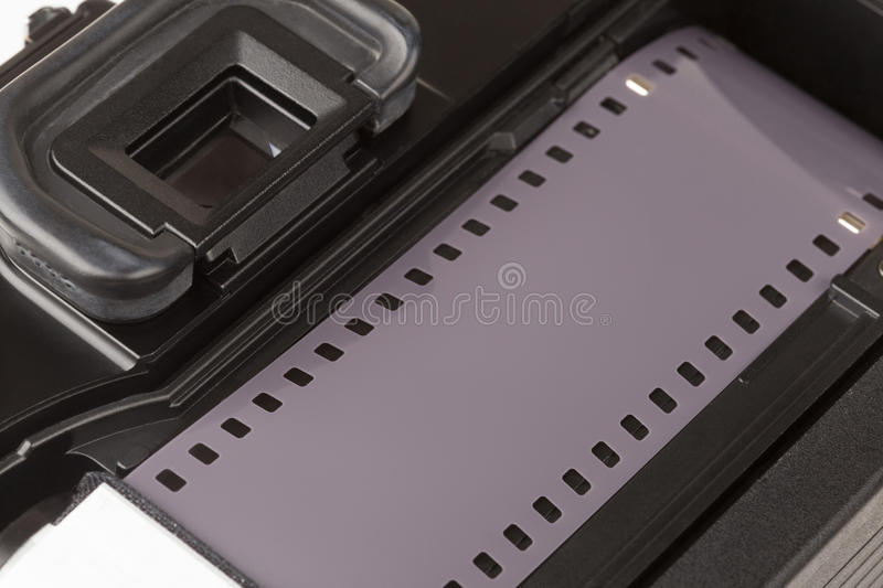 Analog SLR camera. With the inserted film stock photos