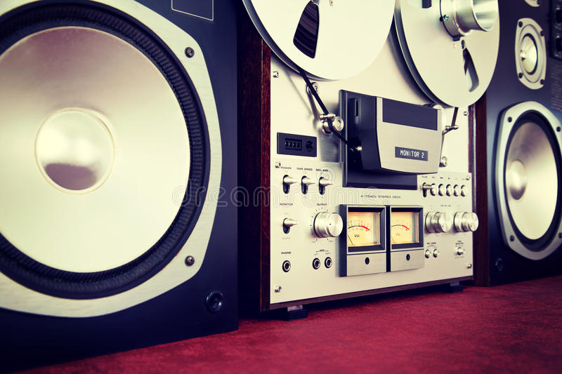 Analog Stereo Open Reel Tape Deck Recorder Vintage with Speakers. Closeup stock photo