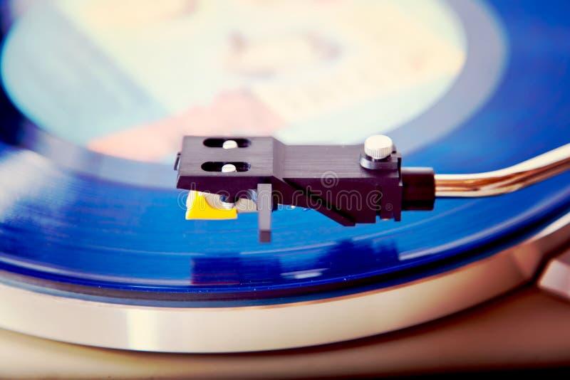 Analog Stereo Turntable Vinyl Blue Record Player Headshell. Cartridge Closeup royalty free stock photo