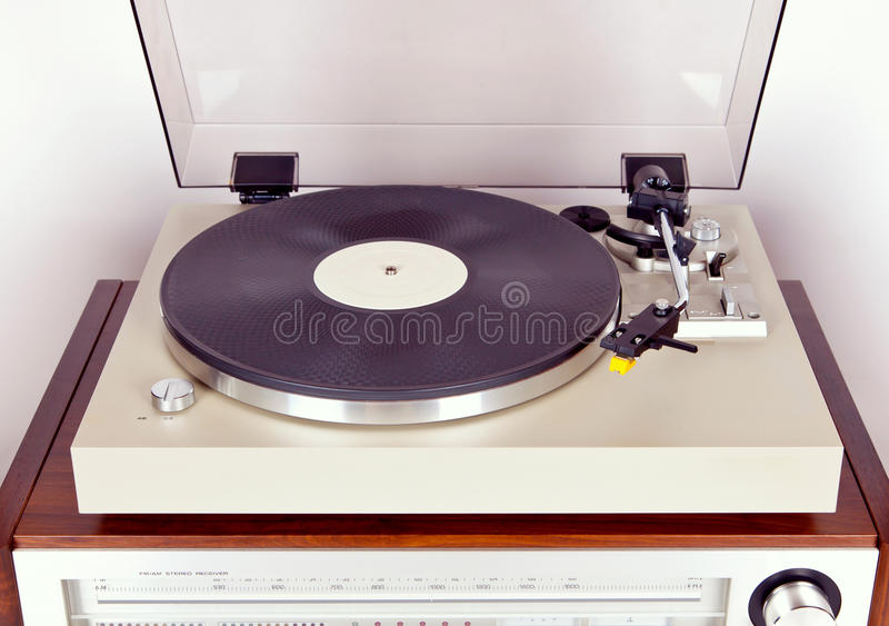 Analog Stereo Turntable Vinyl Record Player with Black Disk. Top View royalty free stock photography