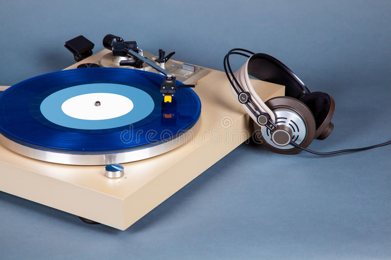 Analog Stereo Turntable Vinyl Record Player with Blue Disk and H. Eadphones royalty free stock images