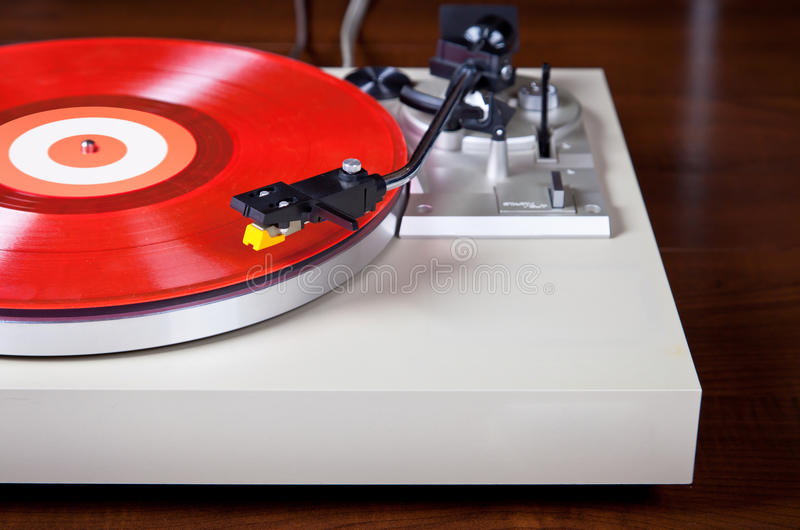 Analog Stereo Turntable Vinyl Record Player. With Red Disk royalty free stock photo