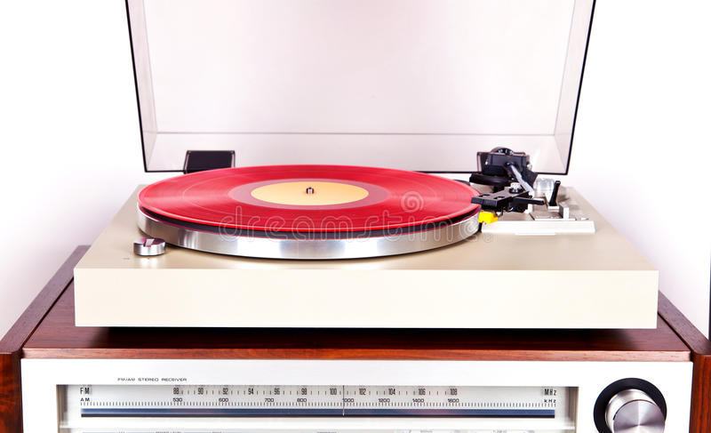Analog Stereo Turntable Vinyl Record Player with Red Disk. Frontal View stock photography