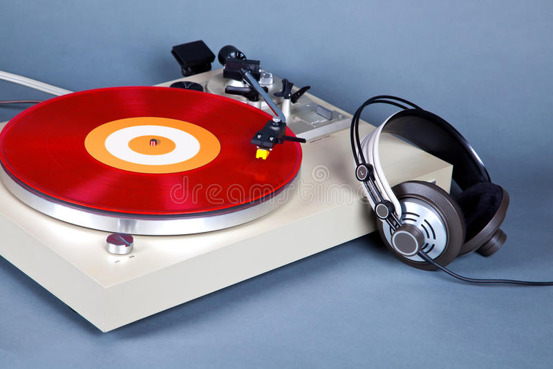 Analog Stereo Turntable Vinyl Record Player with Red Disk and He. Adphones stock photography