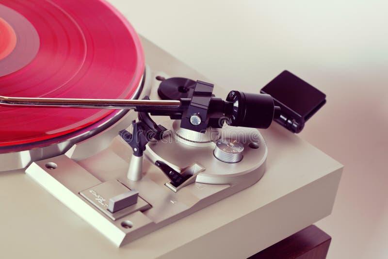 Analog Stereo Turntable Vinyl Record Player Tonearm Closeup. Analog Stereo Turntable Red Vinyl Record Player Tonearm Closeup royalty free stock photos