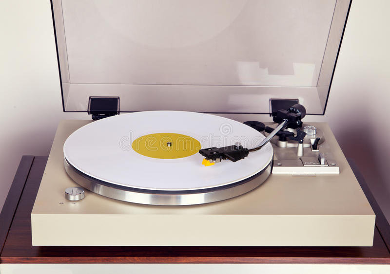Analog Stereo Turntable Vinyl Record Player with White Disk. Frontal View royalty free stock photos