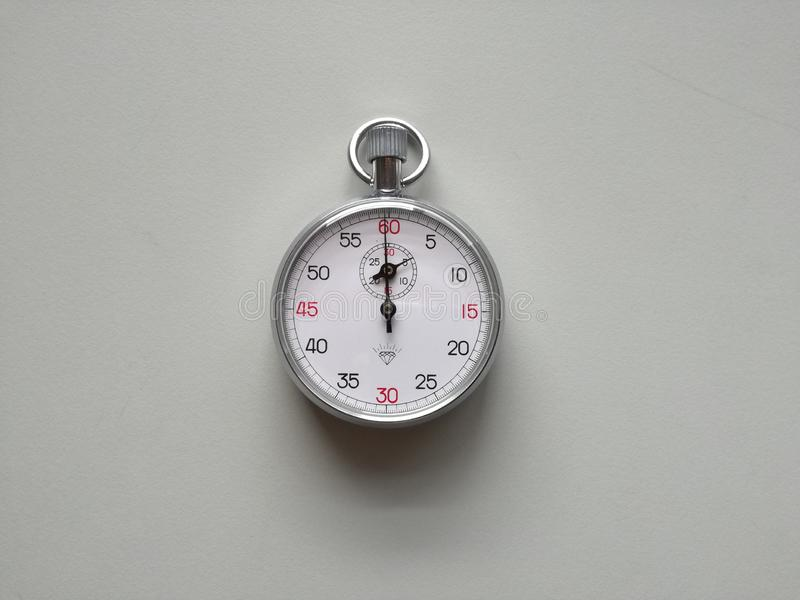 Analog stop watch. In the table,  the photo taken in physics laboratory stock photos