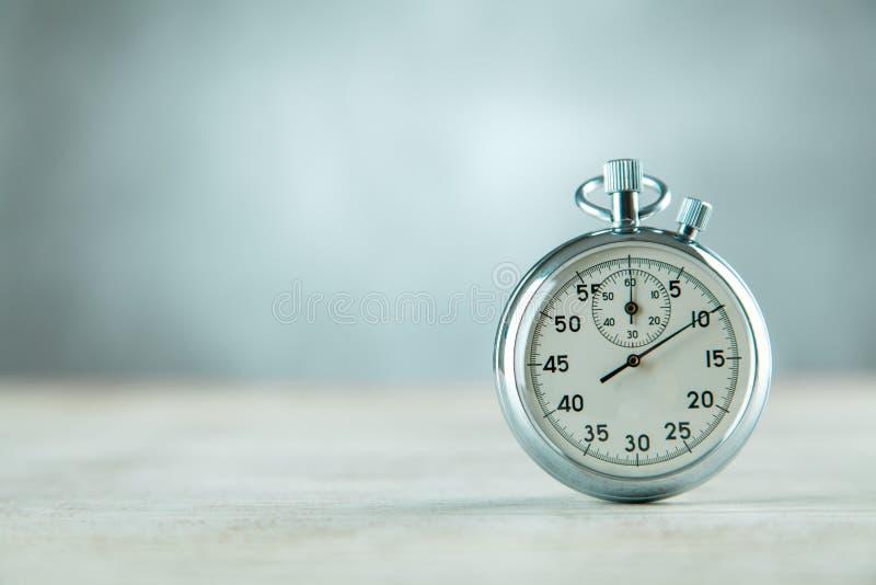 Analog stopwatch on grey background. Analog stopwatch closeup on grey background stock photography