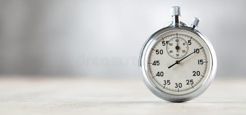 Analog stopwatch on grey background. Analog stopwatch closeup on grey background stock photo