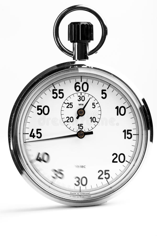 Analog Stopwatch. Silver analog stopwatch with motion on the dial isolated on white royalty free stock photo