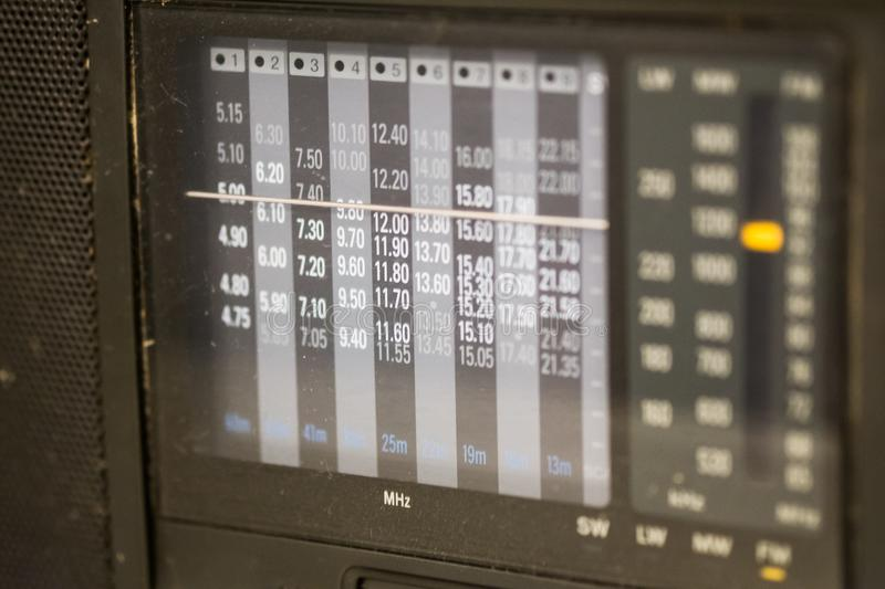 Analog tuning scale of radio frequency. Fragment of retro radio receiver. Analog tuning scale of radio frequency royalty free stock images