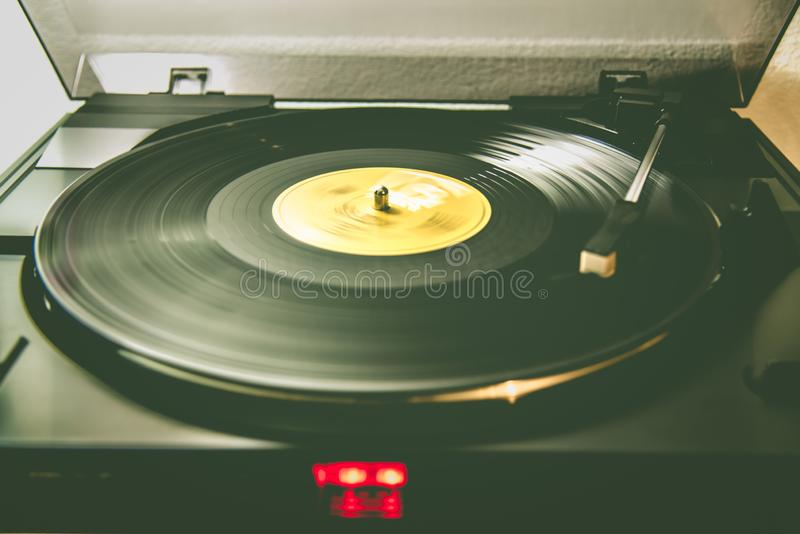 Analog turntable playing vinyl record. Turntable system playing a vinyl record, old best music listening in analog way royalty free stock photos