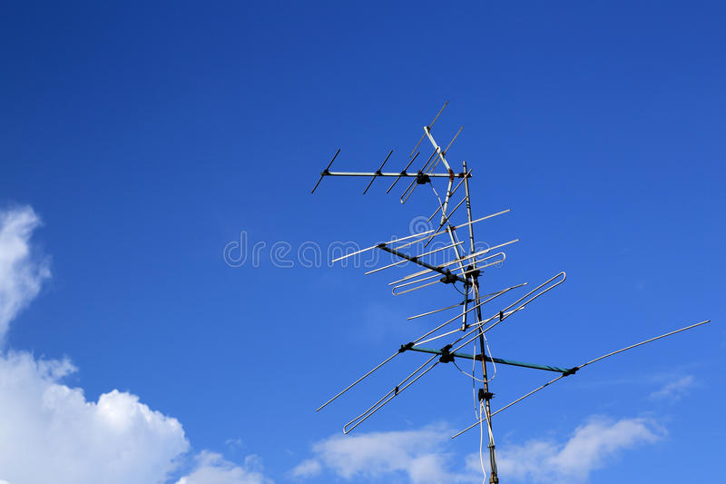 Analog tv antenna with blue sky background.  royalty free stock photos