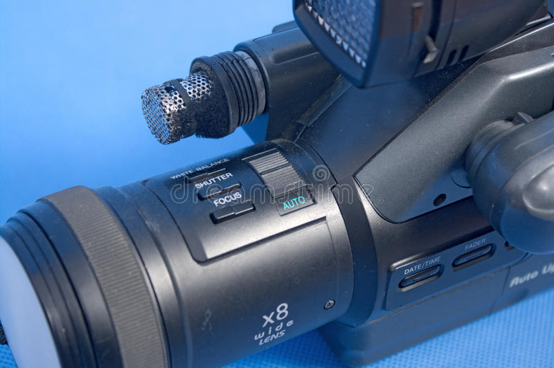 Analog video camera. On a blue background royalty free stock photo