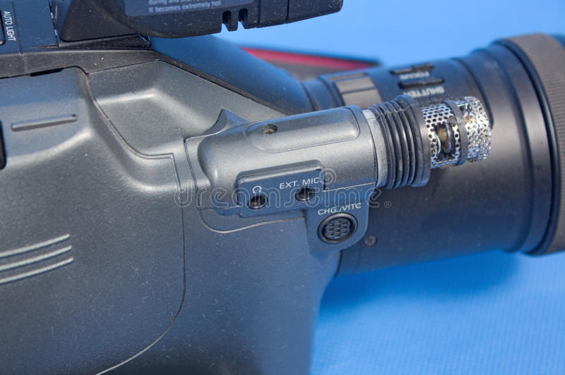 Analog video camera. On a blue background royalty free stock images