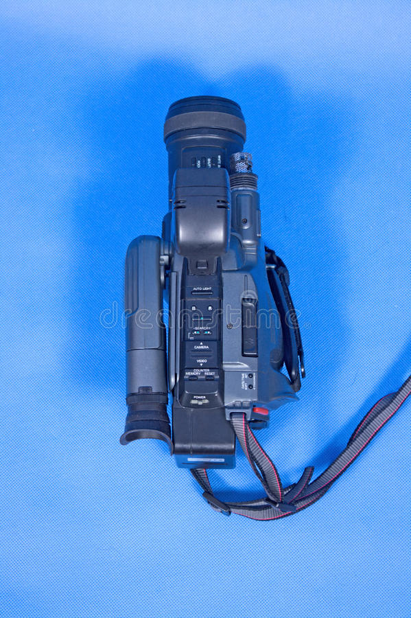 Analog video camera. On a blue background stock photos