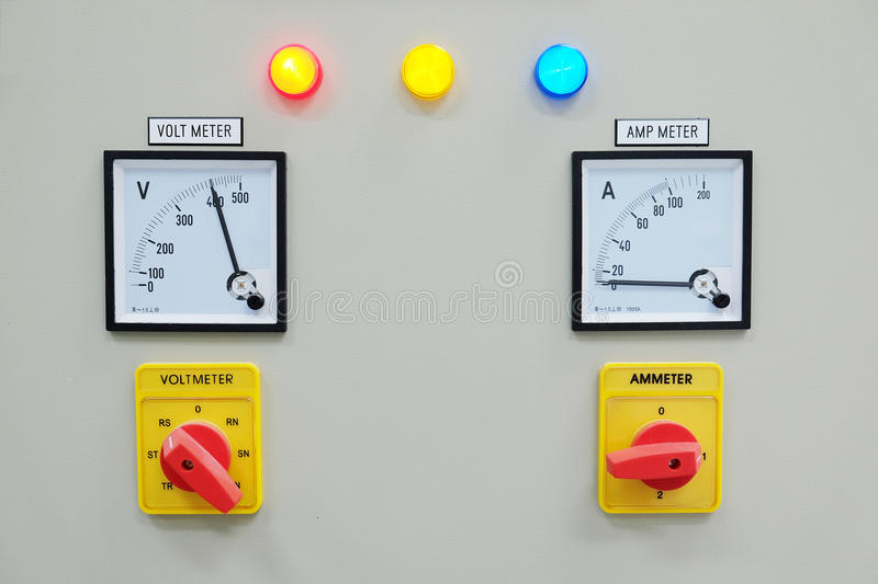 Analog voltmeter, amp meter and signal lamp on control panel. Of power plant royalty free stock image
