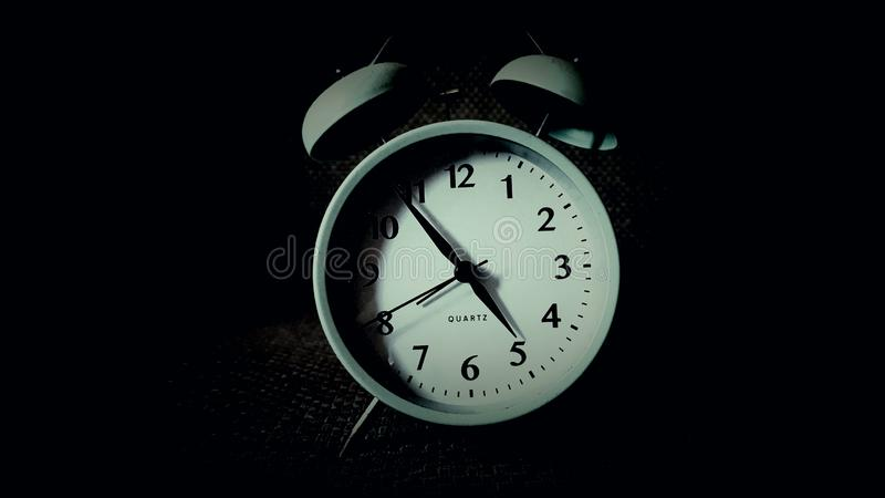 Analog watch. In the dark stock photography
