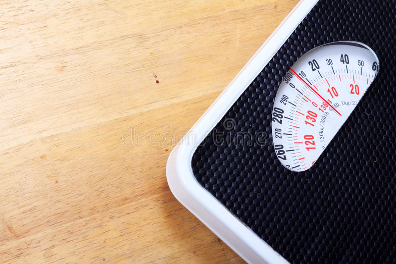 Analog weight scale. On wooden floor stock photo