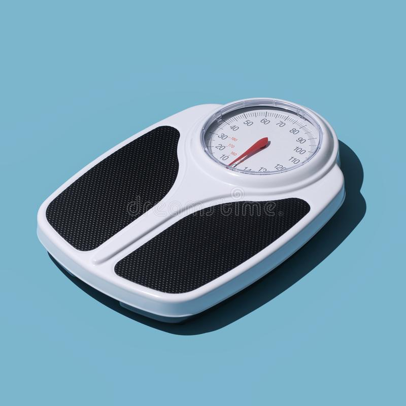 Analog weight scale. Fitness, dieting and weight loss concept royalty free stock photography