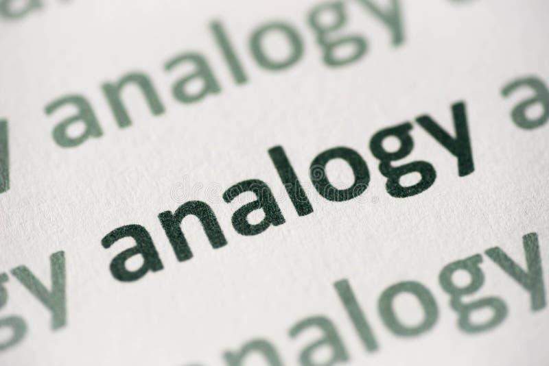 Analogia da palavra impressa no macro de papel imagem de stock