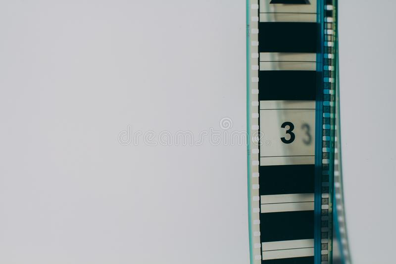 Analogue film strip in right corner with copyspace on white background. Analogue film strip on white background with nuber 3 sign stock photos