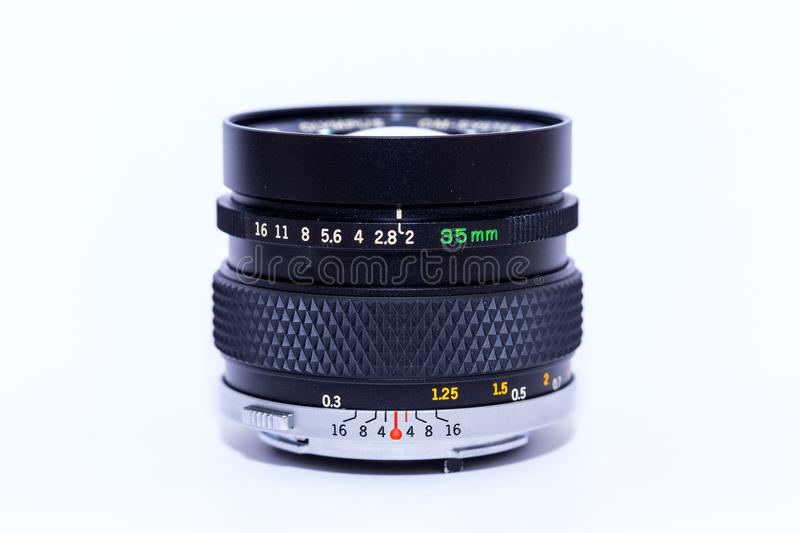 An analogue 35 mm lens. Analogue 35mm old film camera lens stock photo