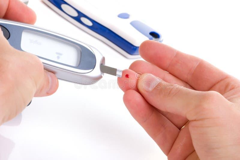 Analyse de sang de niveau de glucose photographie stock