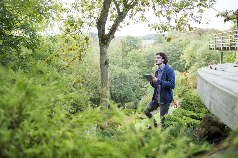 Analysing nature with digital tablet stock photos