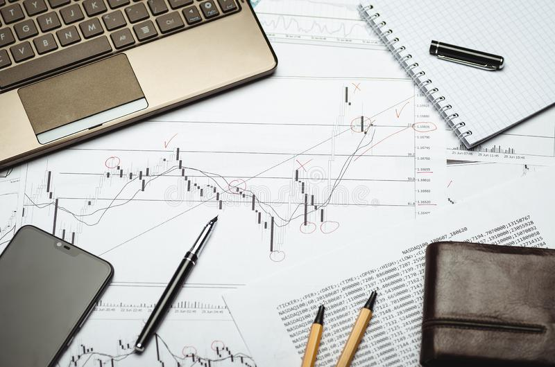 Analysis of financial charts on paper, notebook and pen royalty free stock image