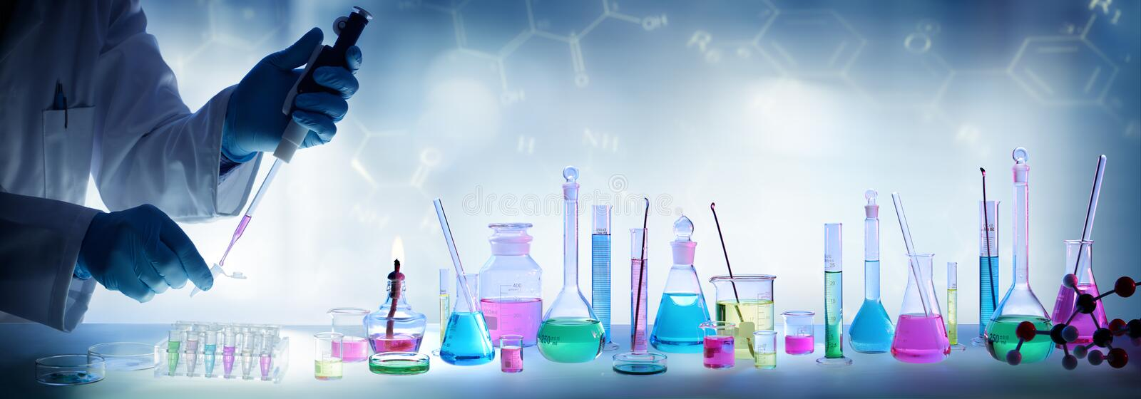 Analysis Laboratory - Scientist With Pipette And Beaker stock photography