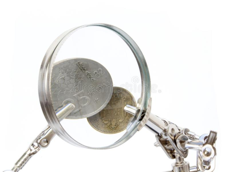 Vintage spanish coins. Analysis of vintage spanish coins stock image