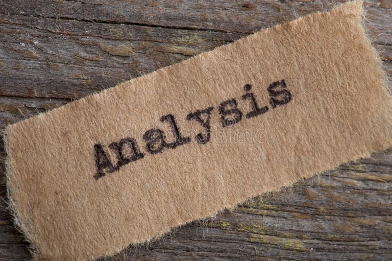 Analysis - word on a piece of paper close up, business creative motivation concept. Success, education, corporate, idea, commerce, creativity, development stock image