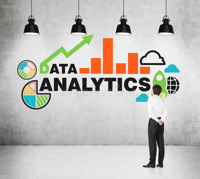 Analyst is standing in front of the drawn chart on the wall. Young analyst is standing in front of the drawn chart on the wall royalty free stock photo