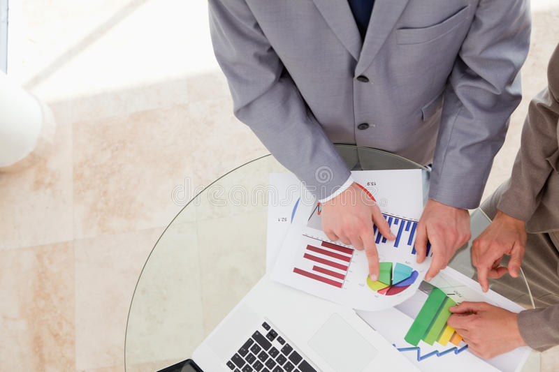 Analysts looking at research data. Together royalty free stock photography