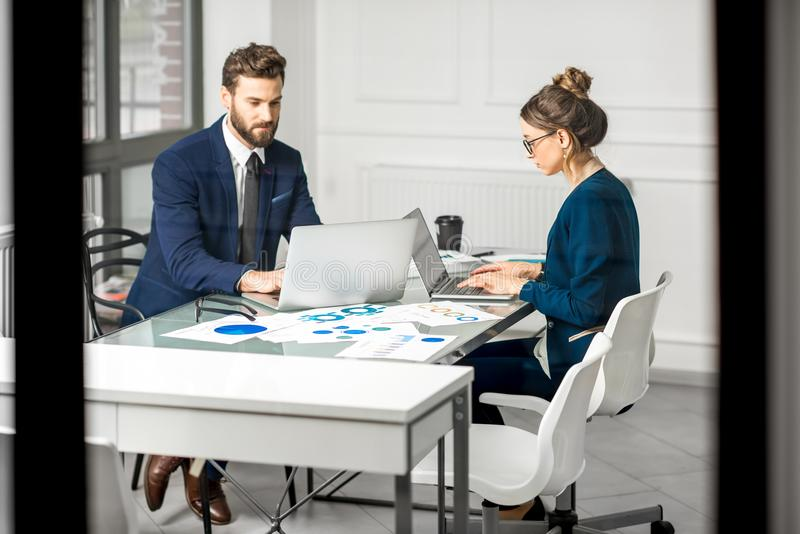 Analytic managers team working at the office stock image