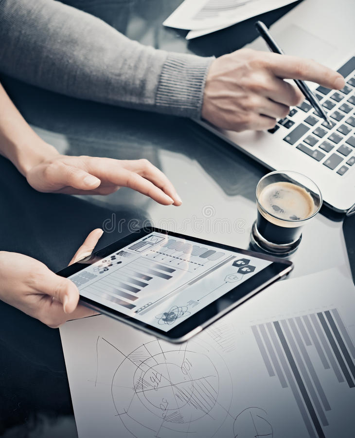 Analytical department working process.Closeup woman showing business reports modern tablet screen.Statistics graphics. Screen.Banker holding pen for signs stock photography