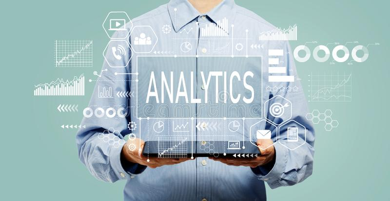 Analytics concept with man holding a tablet royalty free stock photography