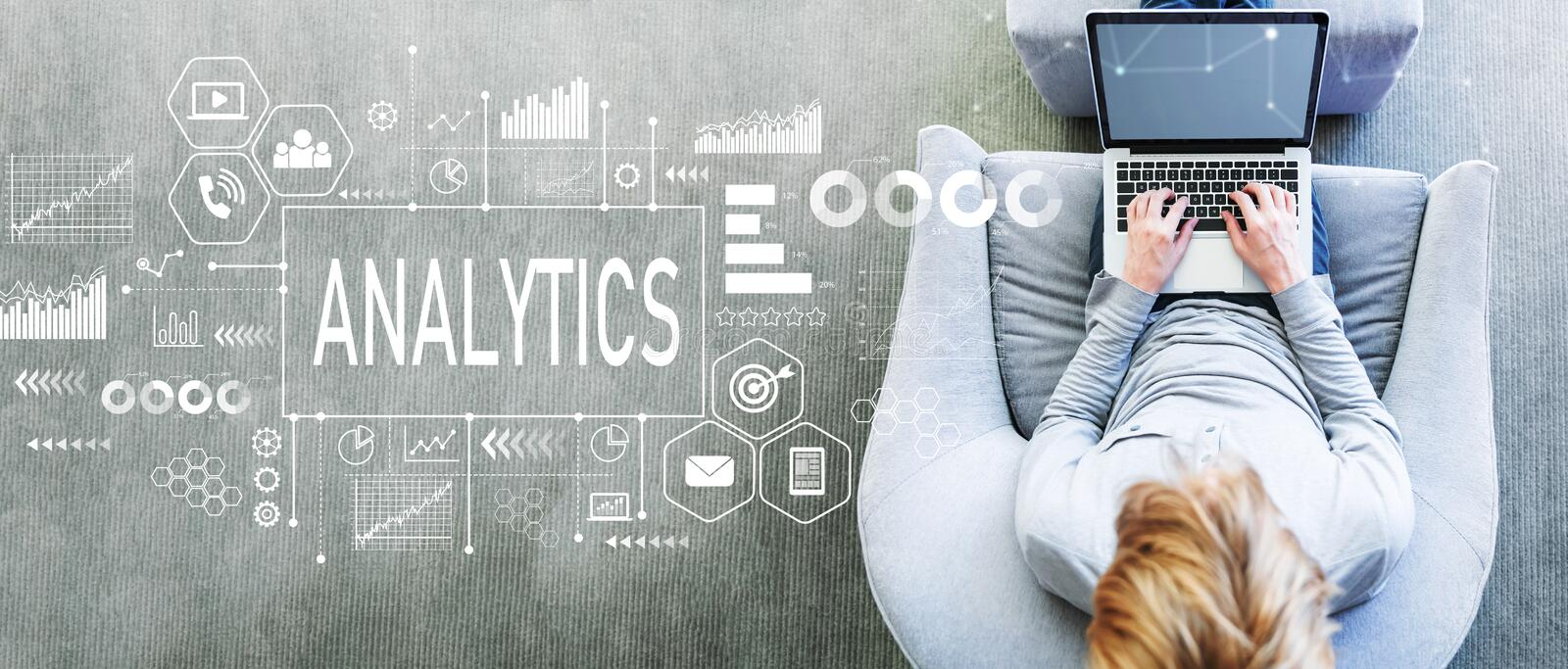 Analytics with man using a laptop stock photo