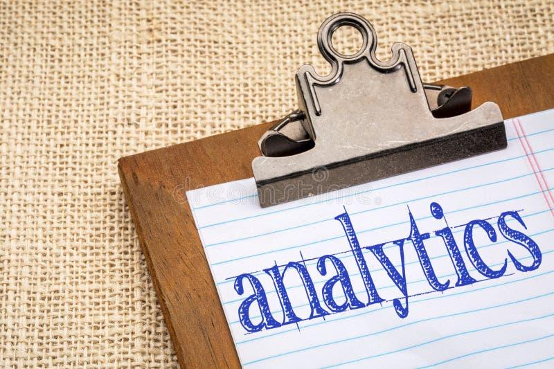 Analytics word on clipboard royalty free stock photo