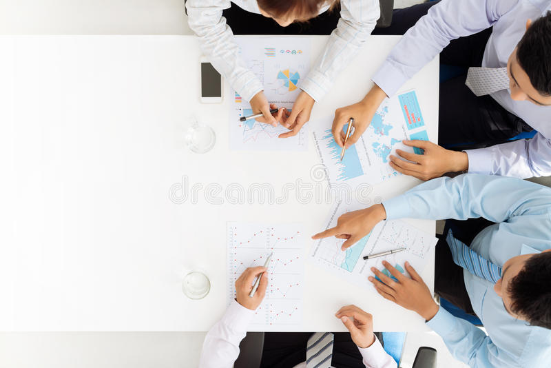 Analyzing financial documents. Business team analyzing financial documents royalty free stock photography