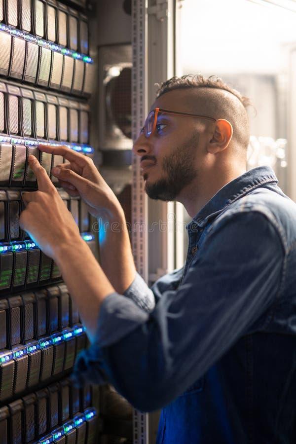 Analyzing sensors of server equipment stock photo