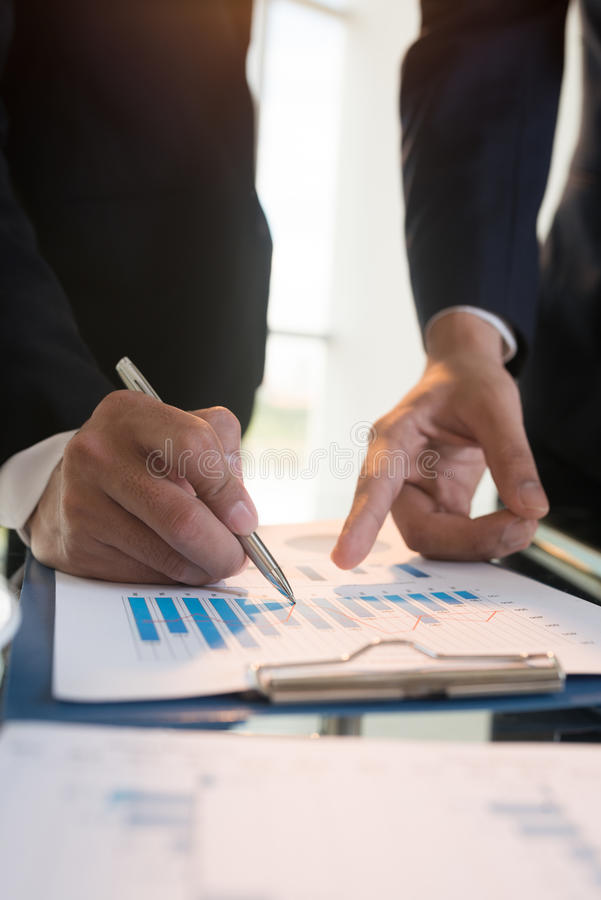 Analyzing statistics. Close-up image of business people analyzing financial charts royalty free stock photography