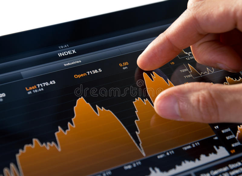 Analyzing Stock Market Chart. Analyzing stock market graph on a touch screen device stock photography