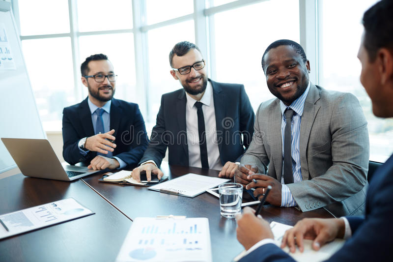 Analyzing Work Results with Colleagues royalty free stock images