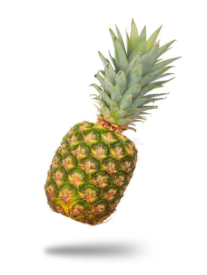 Ananas die in medio lucht drijven stock foto's